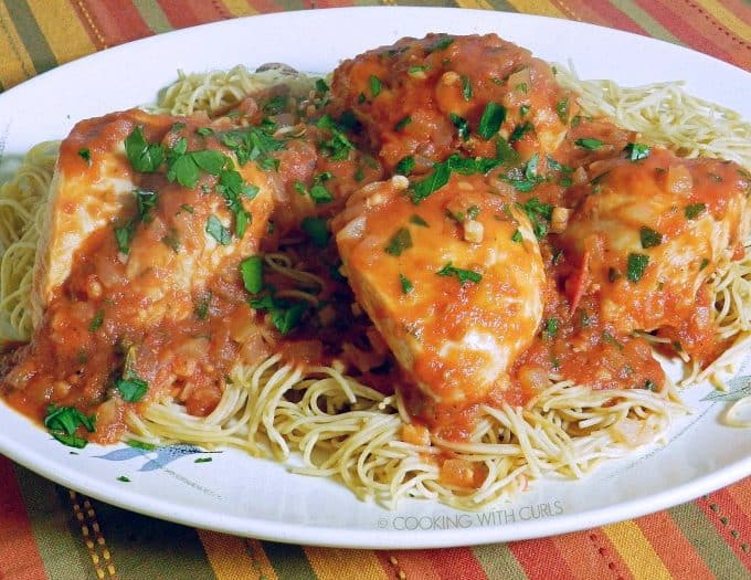 A tangy tomato sauce with the added richness of butter make this Tomato Vinegar Chicken a winner! cookingwithcurls.com