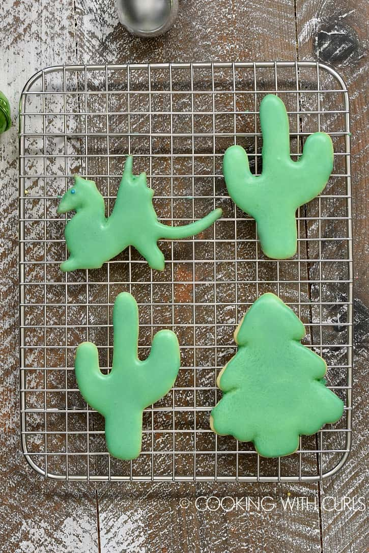 Cut-out Sugar Cookies topped with a simple glaze are exactly what every cookie platter needs! cookingwithcurls.com