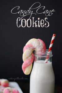 These Candy Cane Cookies have a delicate almond flavor that highlights the crushed peppermint sugar that is sprinkled on top! cookingwithcurls.com