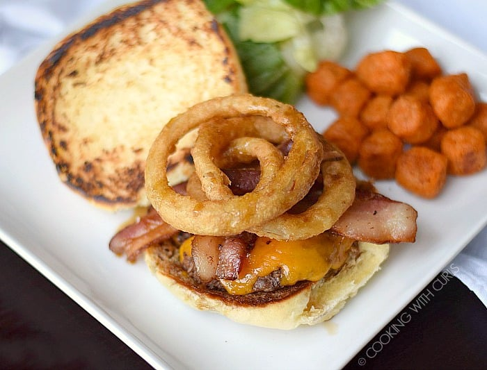 These big, juicy Guinness Burgers topped with Guinness Glaze, cheese, bacon and onion rings are the ultimate comfort food!! cookingwithcurls.com