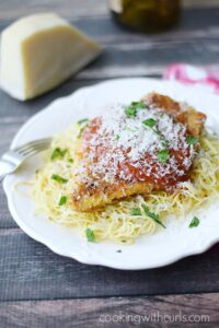 Chicken Parmesan served on a bed of of pasta | cookingwithcurls.com