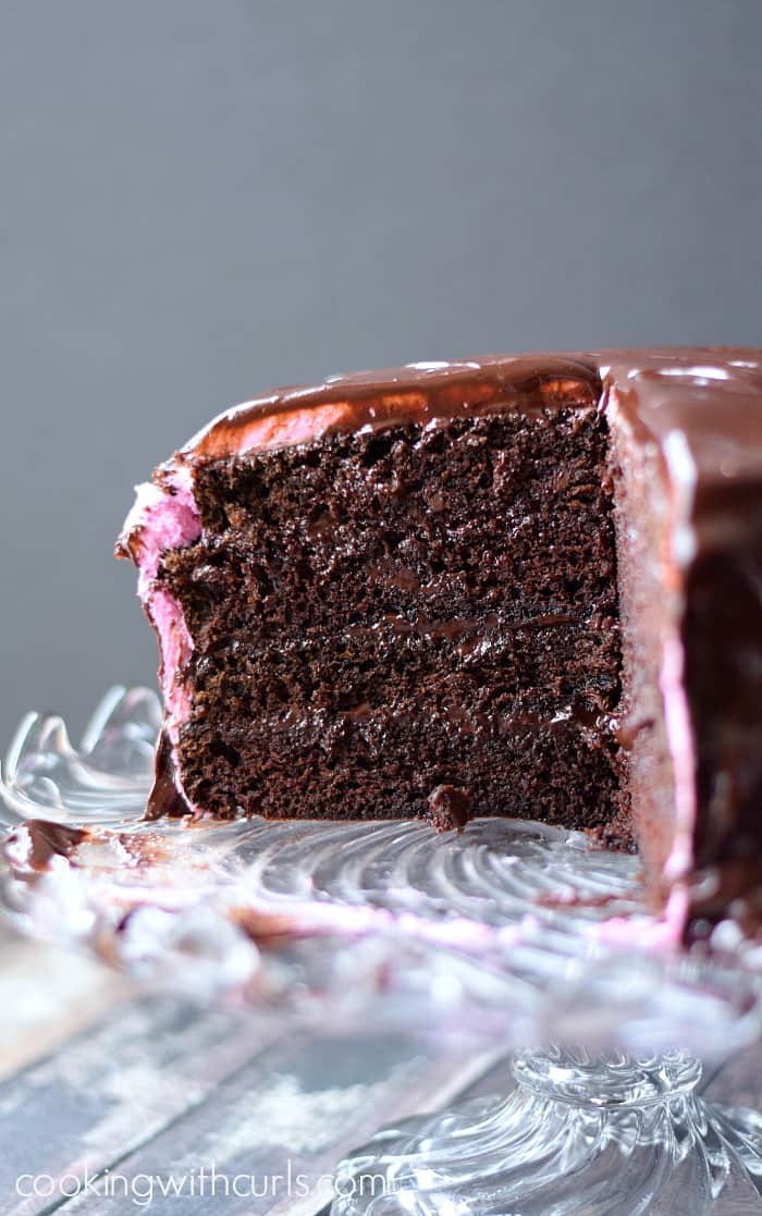 Raspberry Fudge Cake filled with raspberry preserves and chocolate ganache | cookingwithcurls.com