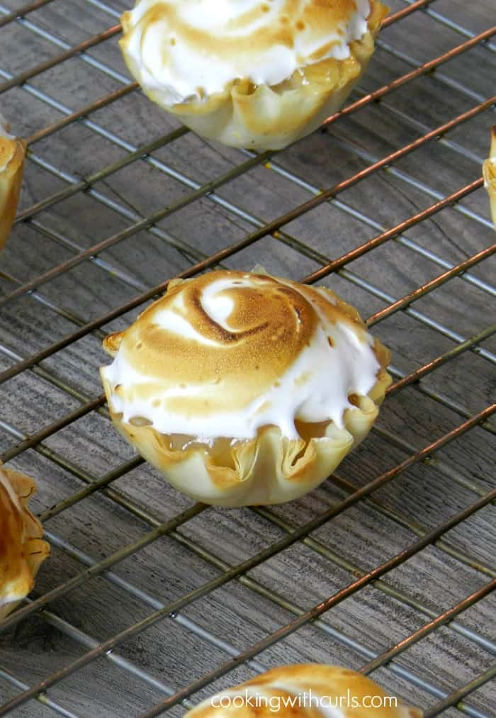 lemon meringue pie bites sitting on a wire cooling rack
