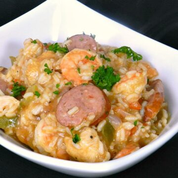 This traditional Shrimp Jambalaya is loaded with shrimp, chicken and sausage in a spicy creole sauce! cookingwithcurls.com