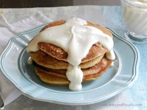 Whole Wheat Cinnamon Roll Pancakes with Cream Cheese Syrup cookingwithcurls.com