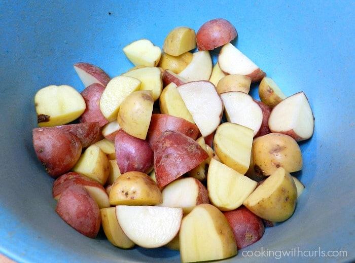 Cut potatoes in a blue bowl.