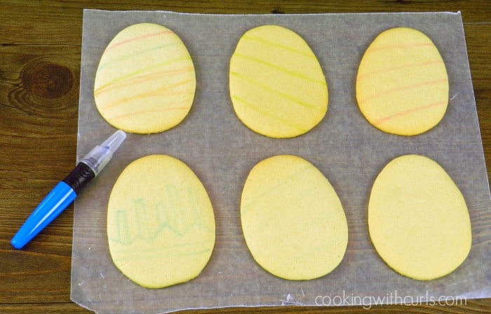 Draw designs on the egg cookies with a food writing pen cookingwithcurls.com