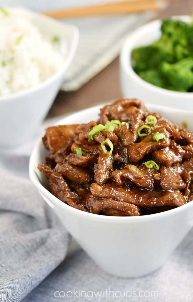 My all-time favorite Mongolian Beef recipe with thinly sliced sirloin, tangy Asian sauce, and sweet caramelized onions will beat out any restaurant meal   cookingwithcurls.com