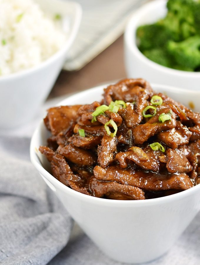 My all-time favorite Mongolian Beef recipe with thinly sliced sirloin, tangy Asian sauce, and sweet caramelized onions will beat out any restaurant meal | cookingwithcurls.com