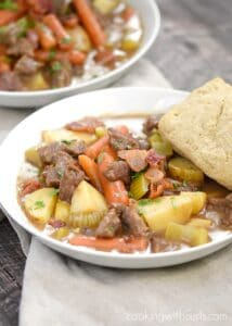 A big white bowl of Beef Stew with Guinness Biscuits sitting on a beige napkin