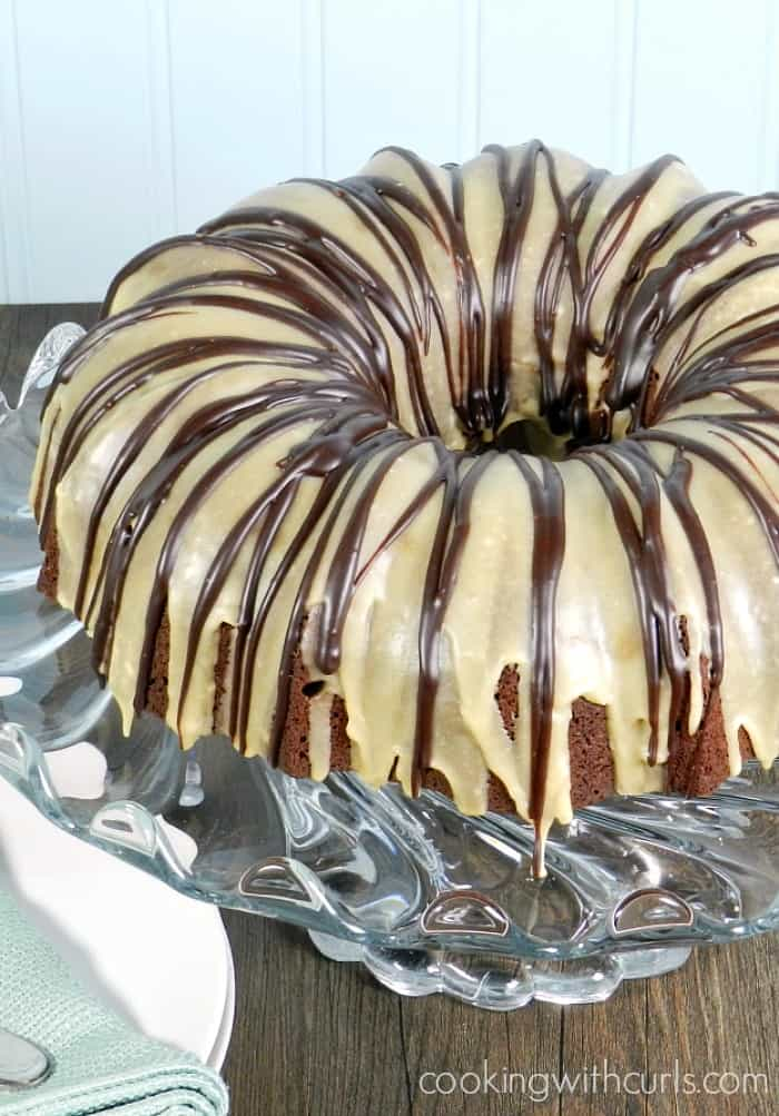 BAILEYS Kiss Cocktail Cake is a chocolate cake with mini kisses then topped with BAILEYS Irish Cream glaze and chocolate ganache! cookingwithcurls.com