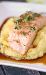 Guinness Glazed Salmon with perfect mashed potatoes is a quick weeknight meal that the whole family will enjoy! cookingwithcurls.com