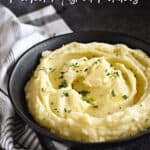 A black bowl filled with mashed potatoes topped with butter, title graphic across the top of the image.