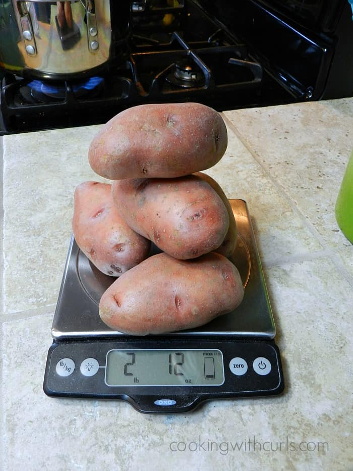 A stack of potatoes on a kitchen scale