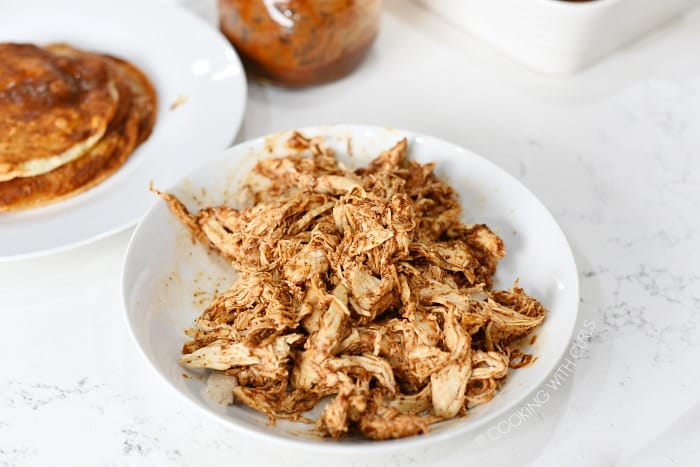 Mix the shredded chicken with red sauce in a small bowl cookingwithcurls.com