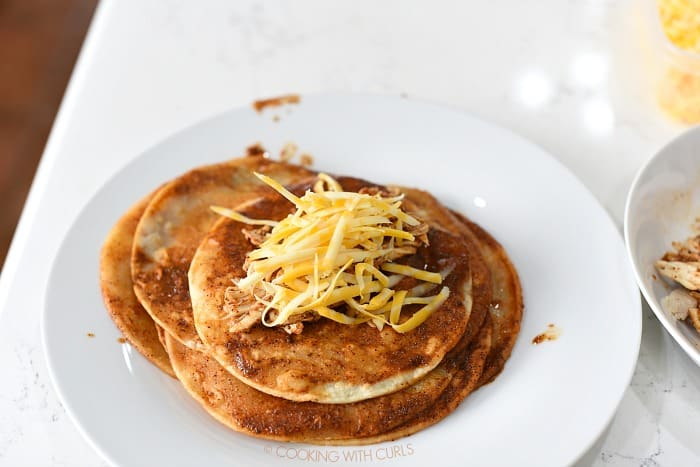 Place a scoop of chicken and cheese in the center of the tortilla cookingwithcurls.com