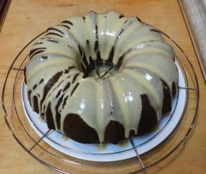 Pour glaze over cake