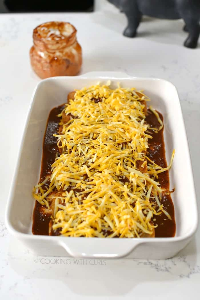 Sprinkle the shredded cheese over the top of the enchiladas cookingwithcurls.com