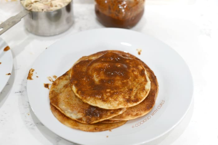 Stack the sauce covered tortillas on a large plate cookingwithcurls.com