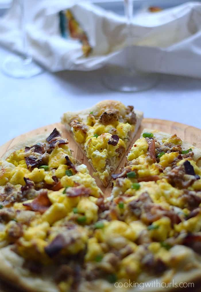 Breakfast Pizza with sausage gravy, bacon, and eggs on a homemade crust | cookingwithcurls.com