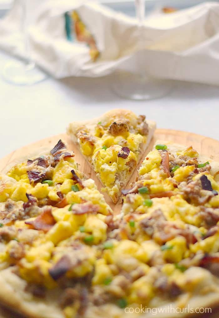 Breakfast Pizza with sausage gravy, bacon and eggs on a homemade pizza crust! cookingwithcurls.com