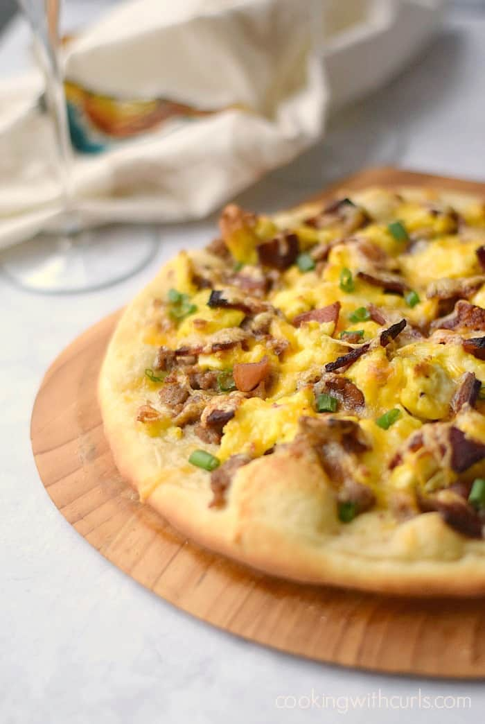 Breakfast Pizza with sausage gravy, eggs and bacon on a homemade pizza crust! cookingwithcurls.com