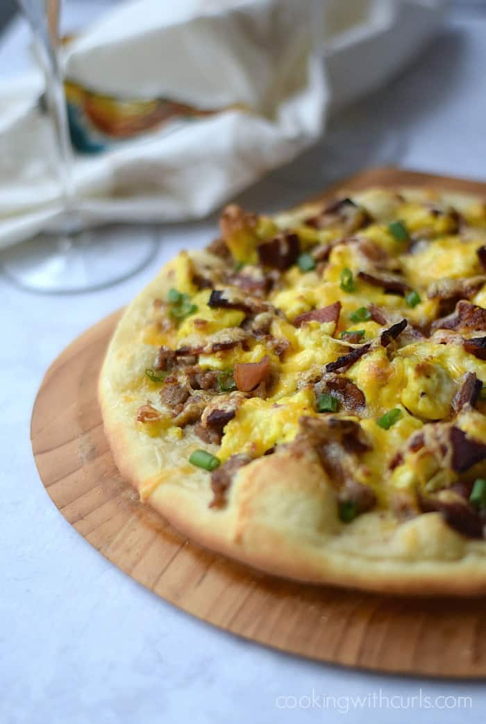 Breakfast Pizza with sausage gravy, eggs, and bacon on a homemade pizza crust | cookingwithcurls.com