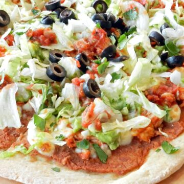 Chicken Tostada Pizza is the perfect solution when you can't decide between pizza or Mexican for dinner! cookingwithcurls.com