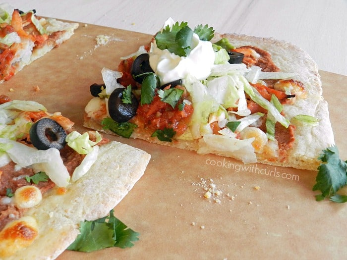 No one can resist a slice of Chicken Tostada Pizza! cookingwithcurls.com