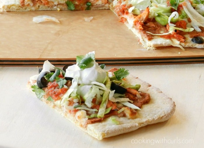 Slice the Chicken Tostada Pizza with Cornmeal Crust and serve! cookingwithcurls.com