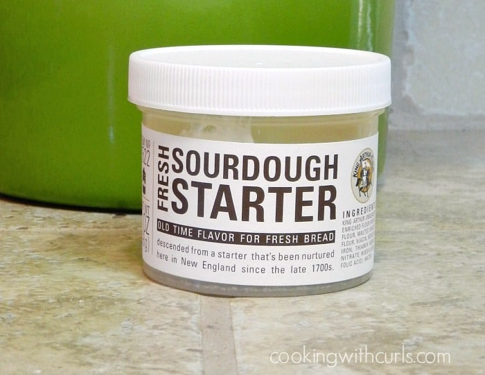 a small plastic container filled with sourdough starter