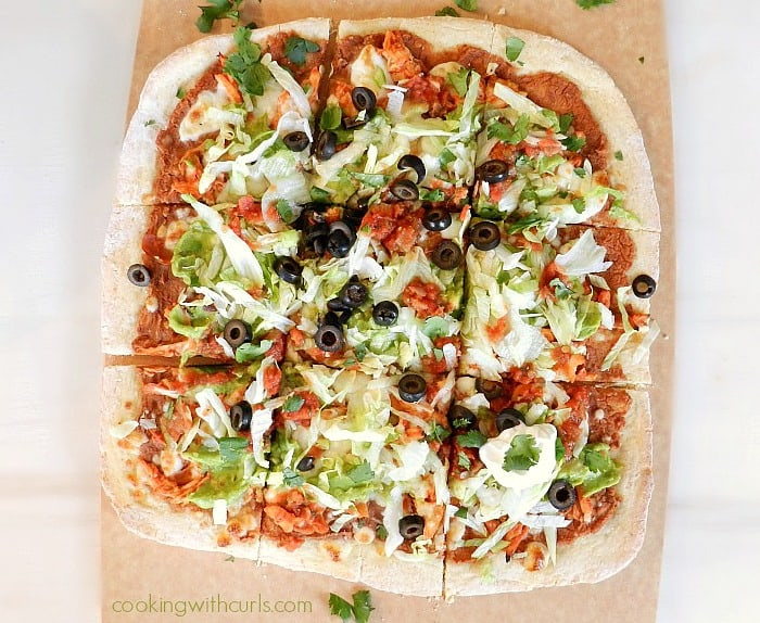 Who wants a slice of Chicken Tostada Pizza with Cornmeal Crust cookingwithcurls.com
