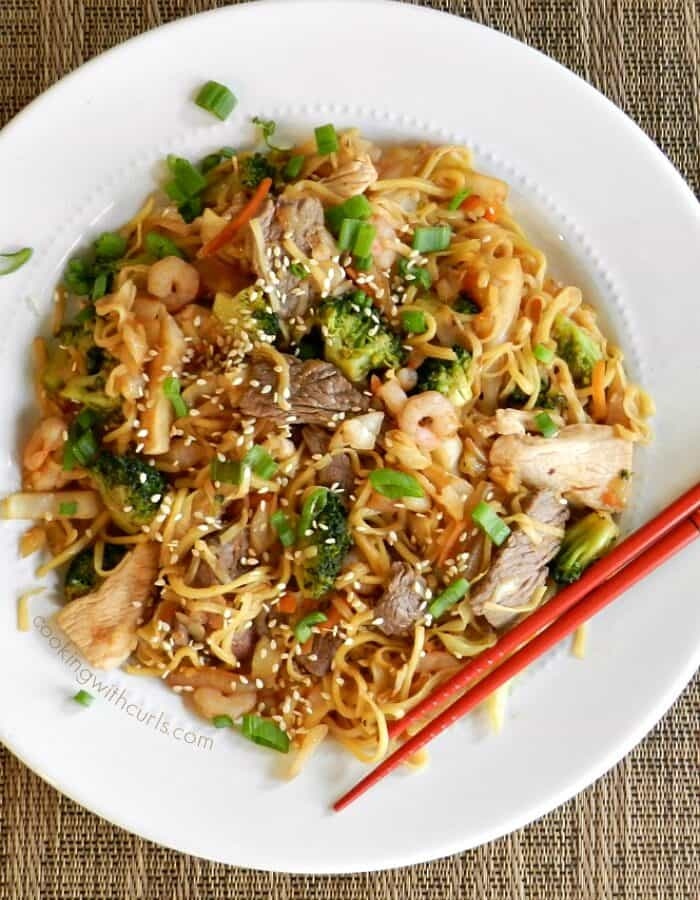 combination yaki soba on a large white plate with red chopsticks in the right hand corner