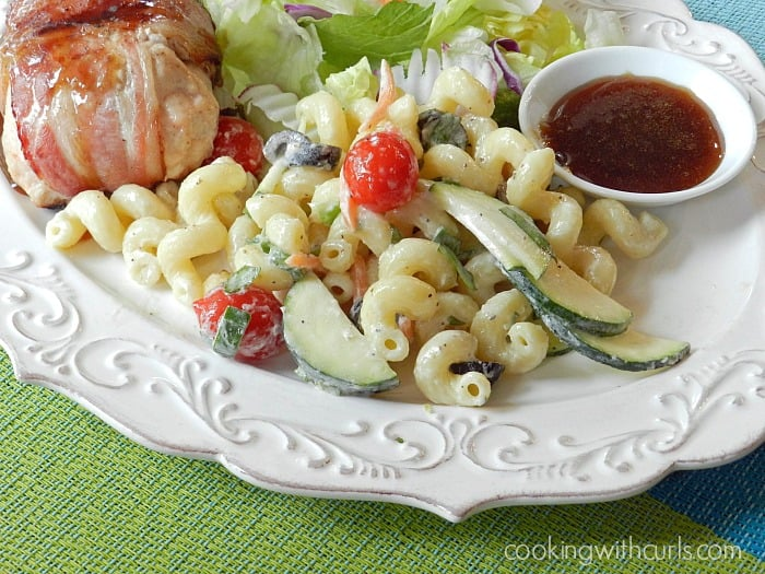 Creamy Italian Pasta Salad loaded with Italian flavors and vegetables is the perfect side dish! cookingwithcurls.com