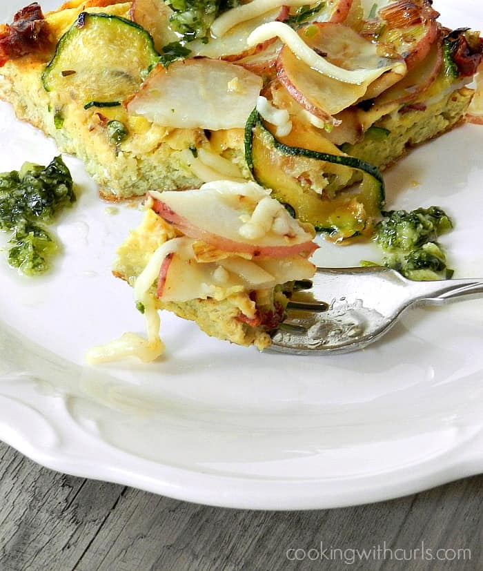 Italian Frittata served with basil sauce on a white plate