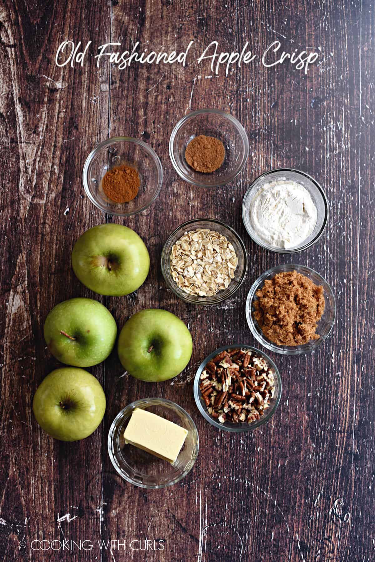 Old Fashioned Apple Crisp Ingredients laying on a wood background.