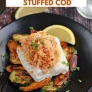 Shrimp and Crab Stuffed Cod on a bed of sautéed zucchini and carrots with a lemon wedge on the side and one on the table and title graphic across the top.