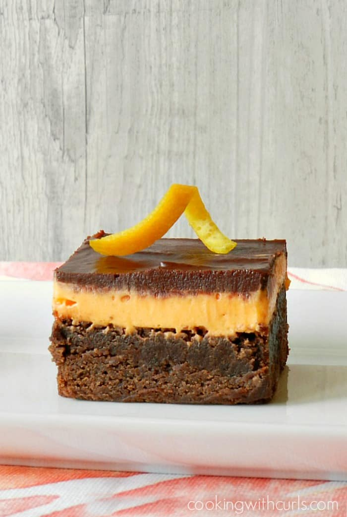 These Orange Boozy Brownies are rich, chocolaty, and spiked with orange liqueur cookingwithcurls.com