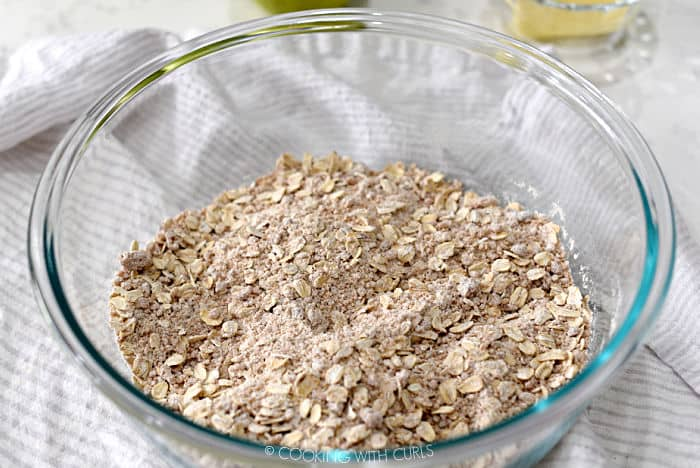 oatmeal, flour and brown sugar mixed together in a glass bowl.