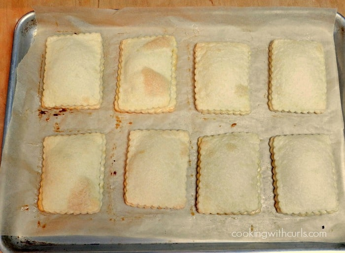 Blonde Fatale Pop Tarts baked on a parchment lined baking sheet.