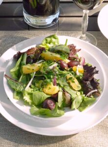 Greek Orange and Olive Salad with mixed salad greens, sweet oranges, onion slivers, and Greek olives drizzled with a simple lemon dressing! cookingwithcurls.com