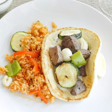 Greek marinated Lamb and Vegetable Kabobs, grilled to perfection with green peppers, zucchini, and pearl onions...served in heated pita with Tzatziki! cookingwithcurls.com