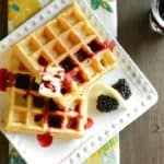 Light and fluffy Lemon Waffles with Blackberry Syrup are a delicious breakfast treat cookingwithcurls.com