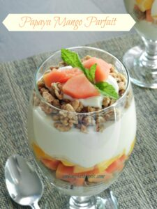 Papaya Mango Parfait with Greek yogurt, granola, and honey from cookingwithcurls.com