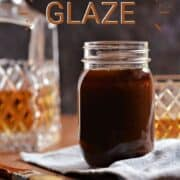 Whiskey glaze in a glass jar with a bottle and glass of whiskey in the background and title graphic across the top.