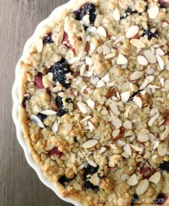Apple-Berry Crumble served with Irish Whiskey Cream is the perfect way to uses up those berries! cookingwithcurls.com