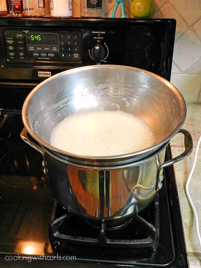 Heat pastry cream in a large stainless steel bowl over a large pot of water cookingwithcurls.com