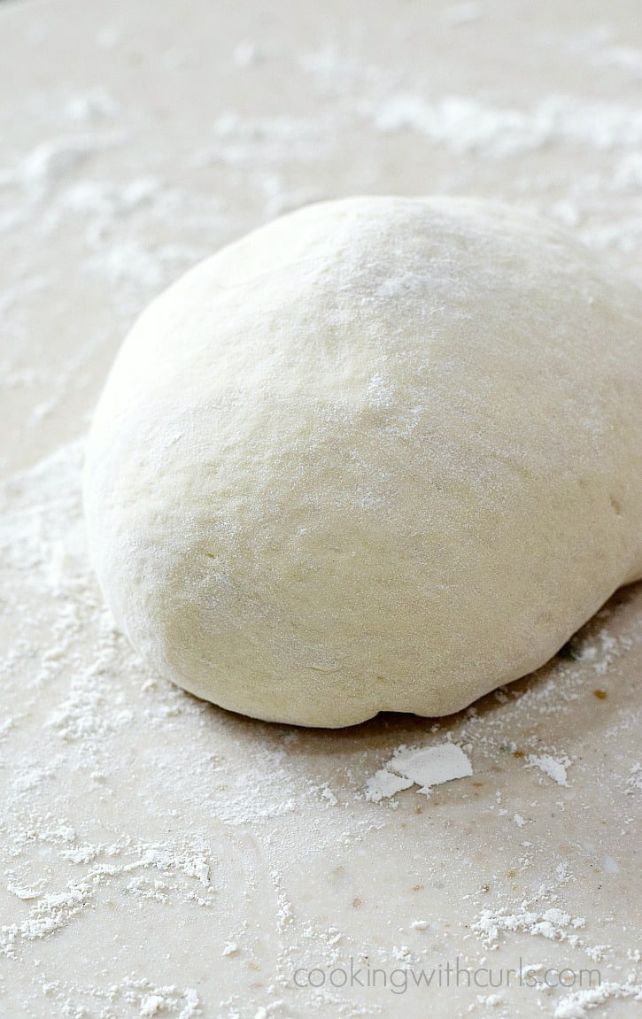 Homemade Pizza Dough made super easy with a bread machine or stand mixer | cookingwithcurls.com