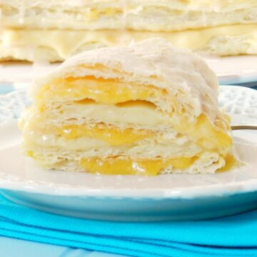 Rich vanilla pastry cream and fresh peach coulis are sandwiched between layers of puff pastry to form these incredible Peaches and Cream Napoleons cookingwithcurls.com