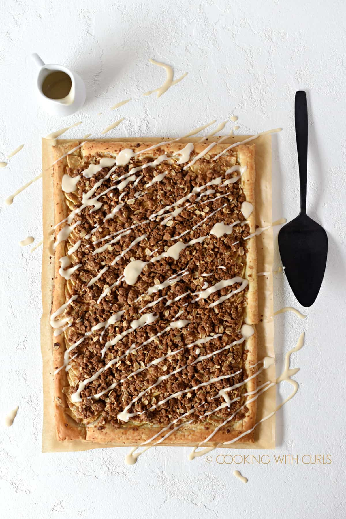 looking down on an Apple Streusel Pizza made with puff pastry and topped with a sweet glaze.